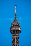 Spire peak of Eiffel Tower Tour Eiffel blue sky steel structure royalty free stock photography