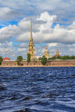 The spire of the Peter and Paul Fortress in St. Petersburg. In a sunny day, the view from the Neva Stock Photos