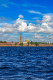The spire of the Peter and Paul Fortress in St. Petersburg. In a sunny windy summer day, the view from the Neva Stock Photography