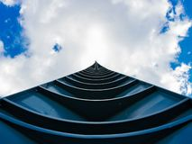 Spire pointing at partially cloudy sky. royalty free stock photos