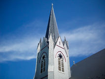 Spire Of St Joseph Catholic Church. Built in 1910, this church has a spire which reaches for the deep blue sky and towers over all other buildings in North Royalty Free Stock Photography