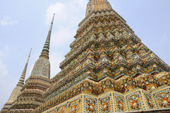 Spired temples, Thailand. Ornate spires of temples in Thailand Royalty Free Stock Photos