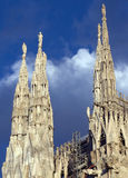 Spires of Duomo of Milan. Detail from Duomo of Milan, in Italy: spires and clouds Royalty Free Stock Photos