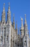 Spires of Duomo with statue Royalty Free Stock Images