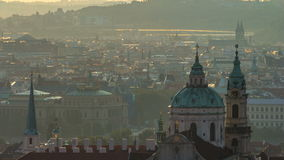 Spires of the old town and St Nicolas church at sunrise timelapse. czech republic, prague. View from Strahov Monastery at dawn stock video
