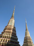 Spires of a Thai Buddhist Temple. Architectural Detail of a Thai Buddhist Temple, Specifically the Stupa or Spires of Wat Pho in Bangkok Stock Image