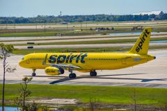 Spirit Airlines  aircraft on runway preparing for departure from the Orlando International Airport MCO 1