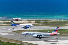Spirit Airlines and American Airlines aircraft on runway in Montego Bay. Montego Bay, Jamaica - March 27 2015: Spirit Airlines and American Airlines aircraft on stock photography