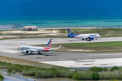 Spirit Airlines and American Airlines aircraft in Montego Bay. Montego Bay, Jamaica - March 27 2015: Spirit Airlines and American Airlines aircraft on runway royalty free stock photo