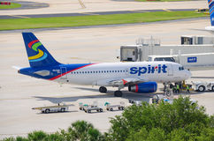 Spirit Airlines plane at airport boarding bridge Royalty Free Stock Photos