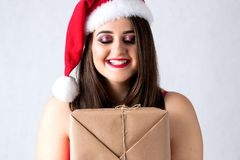 Spirit of Christmas thick girl in santa claus cap model XXL, wom Royalty Free Stock Images