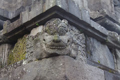 Spirit face made of stone as a block in a wall of a Hindu temple Stock Images