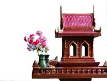 Spirit house in thailand with flower vases Stock Photography