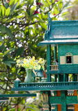 Spirit house in thailand with flower vases Royalty Free Stock Photo