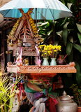 Spirit house in thailand with flower vases Royalty Free Stock Images