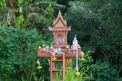 Spirit house in thailand with garland Stock Photo