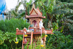 Spirit house in thailand with garland Royalty Free Stock Image