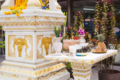 Spirit house in thailand with garland and some wreathes. Joss house Royalty Free Stock Photography