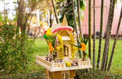 Spirit house in thailand with garland and some wreathes. Joss house Stock Photos