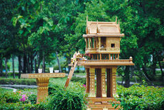 Spirit house in thailand with garland and some wreathes, joss house Royalty Free Stock Image