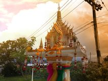 Spirit house in thailand with garland and some wreathes,. Decoration, garland, home, asia, religion Royalty Free Stock Images