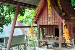 Spirit house in thailand with garland and some wreathes,. Decoration, garland, home, asia, religion Royalty Free Stock Photography