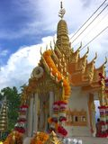 Spirit house in thailand with garland and some wreathes,. Decoration, garland, home, asia, religion Royalty Free Stock Photos