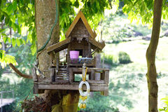 Spirit house on tree outdoor Stock Images
