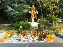 Spirit house worship ceremony with food set royalty free stock photography