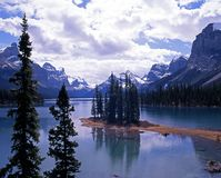 Spirit Island, Maligne Lake, Canada. Spirit Island in Maligne Lake with snow capped mountains to the rear, Alberta, Canada Stock Image
