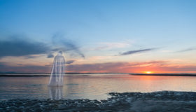 Spirit Of Jesus Christ. Jesus Christ Walking on water towards a sunset Stock Photography
