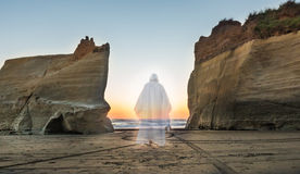 Spirit of Jesus Light. Jesus walking between to cliffs into the light Royalty Free Stock Images