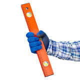 Spirit leve in hand. Working hand with protection glove holding spirit level isolated on white background royalty free stock photo