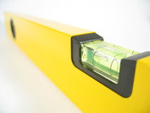 Spirit Level. Yellow spirit level on white background Royalty Free Stock Photography