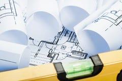 Spirit level and architecture blueprints Royalty Free Stock Photos
