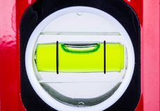 Spirit level bubble close up. Showing perfectly level alignment. Workman tool for finding the horizontal Royalty Free Stock Images