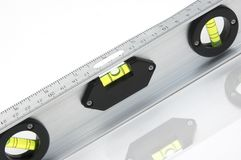 Spirit level or bubble level. Closeup of a bubble or spirit level used in building or construction.  White background Royalty Free Stock Image