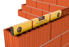 Spirit level. Close up view of a brick wall and a spirit level (3d render Royalty Free Stock Image
