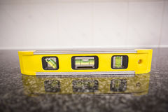 Spirit level on the counter Stock Photography