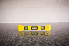 Spirit level on the counter Royalty Free Stock Photos