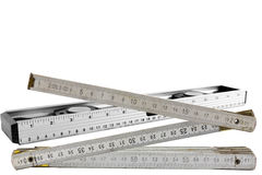Spirit level and a folding rule on white Royalty Free Stock Photos