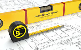 Spirit level and tape measure Stock Images