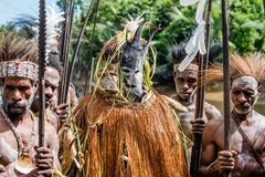 Spirit mask ceremony. YOUW VILLAGE, ATSY DISTRICT, ASMAT, NEW GUINEA, INDONESIA - MAY 23: The Village follows the ancestors embodied in spirit mask as they tour Royalty Free Stock Image