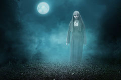 Spirit nun asian woman haunting. The forest at midnight Royalty Free Stock Photos