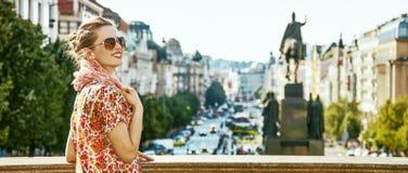 Tourist woman on Vaclavske namesti in Prague having excursion. The spirit of old Europe in Prague. happy modern tourist woman on Vaclavske namesti in Prague Stock Image