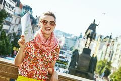 Happy traveller woman on Vaclavske namesti in Prague with map Royalty Free Stock Photos