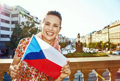 Smiling woman on Vaclavske namesti in Prague showing flag Royalty Free Stock Photography