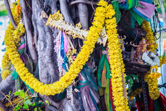 Spirit Thailand Banyan tree adorned with ribbons and spiritual a. Rtifacts Royalty Free Stock Photo