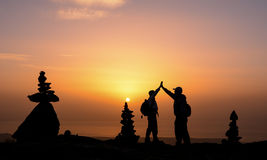 The spirit of unity and solidarity with the successful climb. Zen stones and sunrise at the summit.Zen stones and sunrise.New day and positive energy.Success royalty free stock image