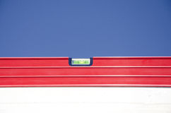Red spirit level outdoor construction blue sky Royalty Free Stock Photo